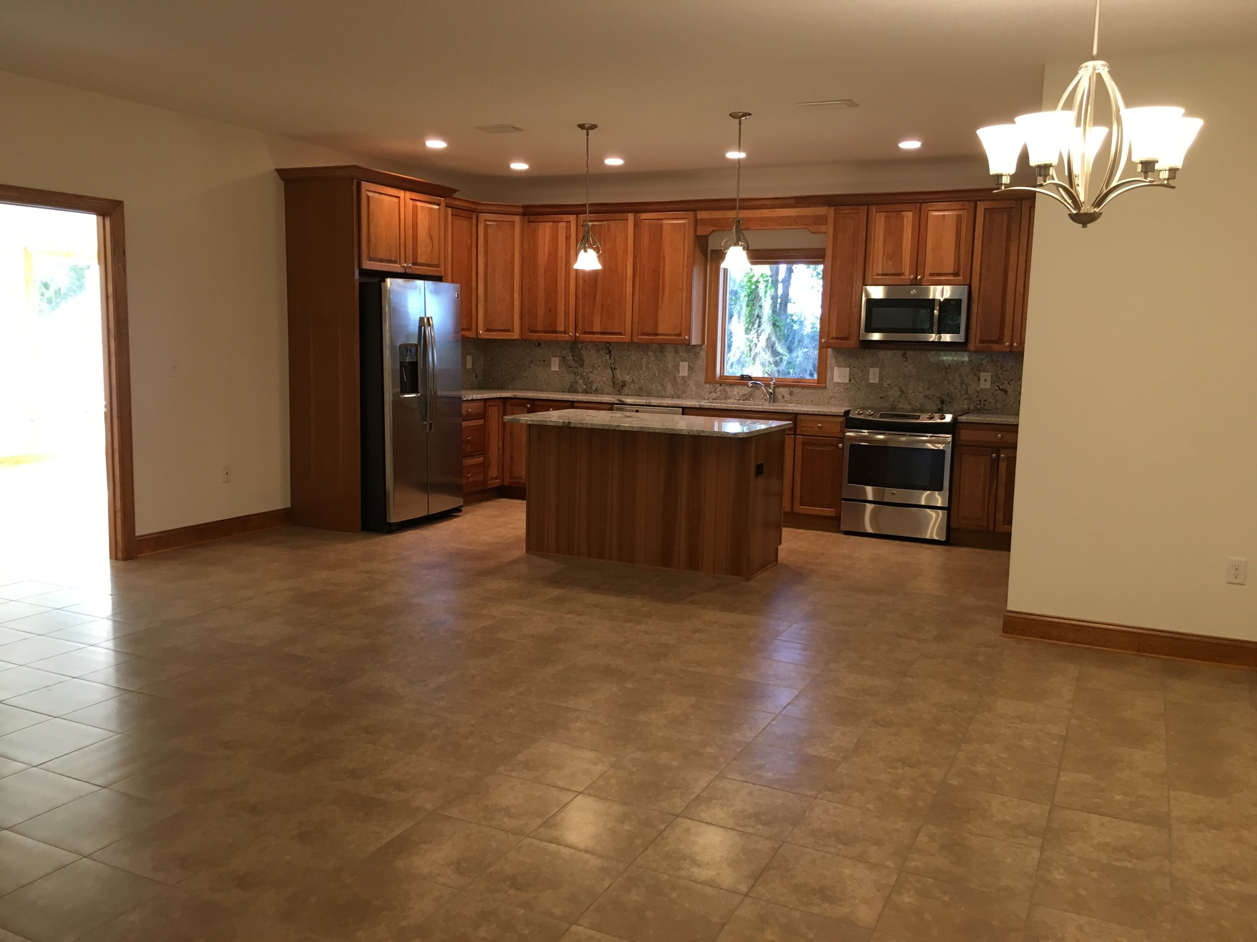Open Floorplan with Kitchen, Dining & Living Areas