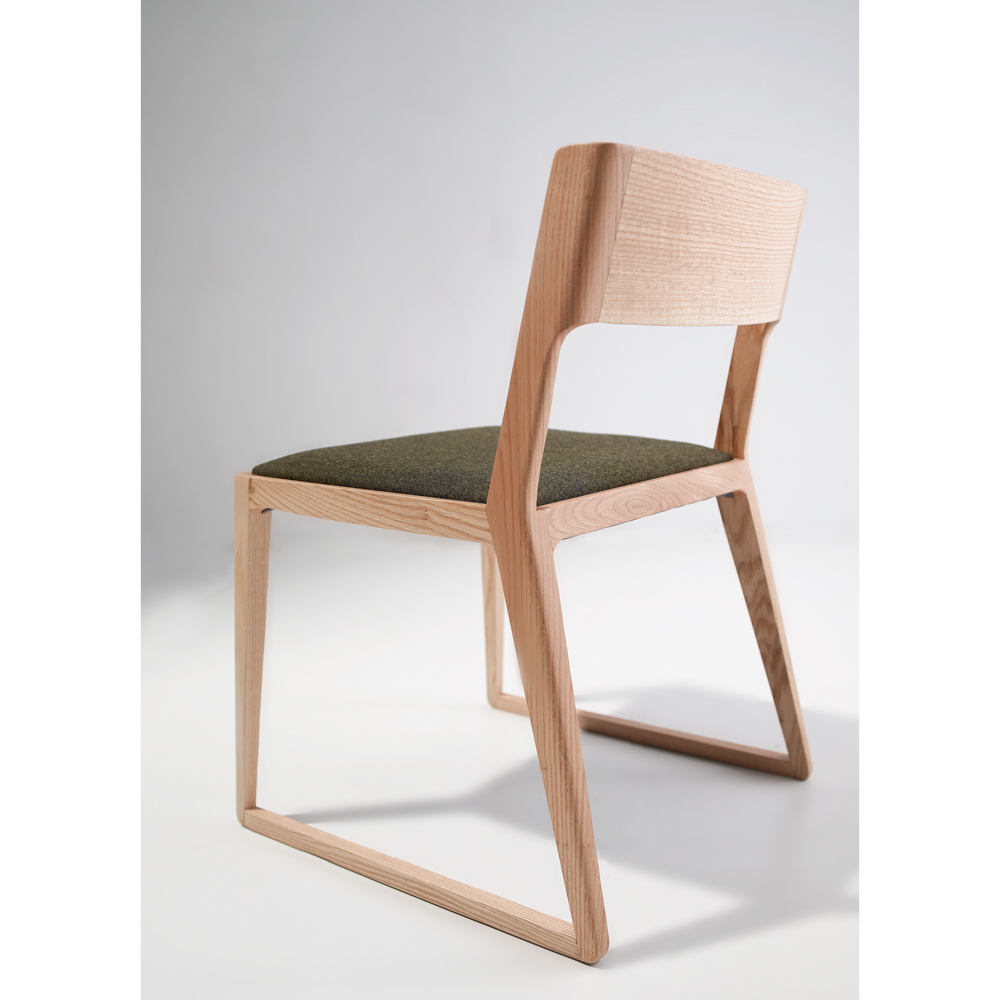 Jane_Hamley_Wells_NORD_2-167_A_modern_dining_chair_upholstered_seat_with_wood_sled_base.jpg