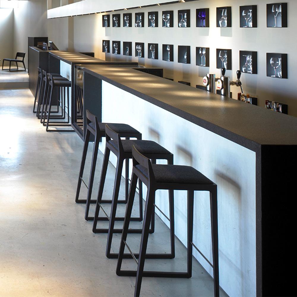 Jane_Hamley_Wells_NORD_10-169_10-176_B_modern_restaurant_bar_stool_upholstered_seat_on_beech_or_oak_wood-1.jpg
