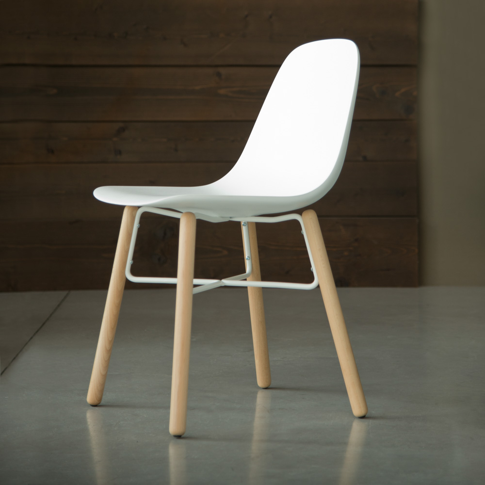 Jane_Hamley_Wells_BABETTE_BABW_A_modern_cafe_restaurant_side_chair_molded_polyurethane_seat_on_wood_legs_with_contrasting_metal_stretchers.jpg