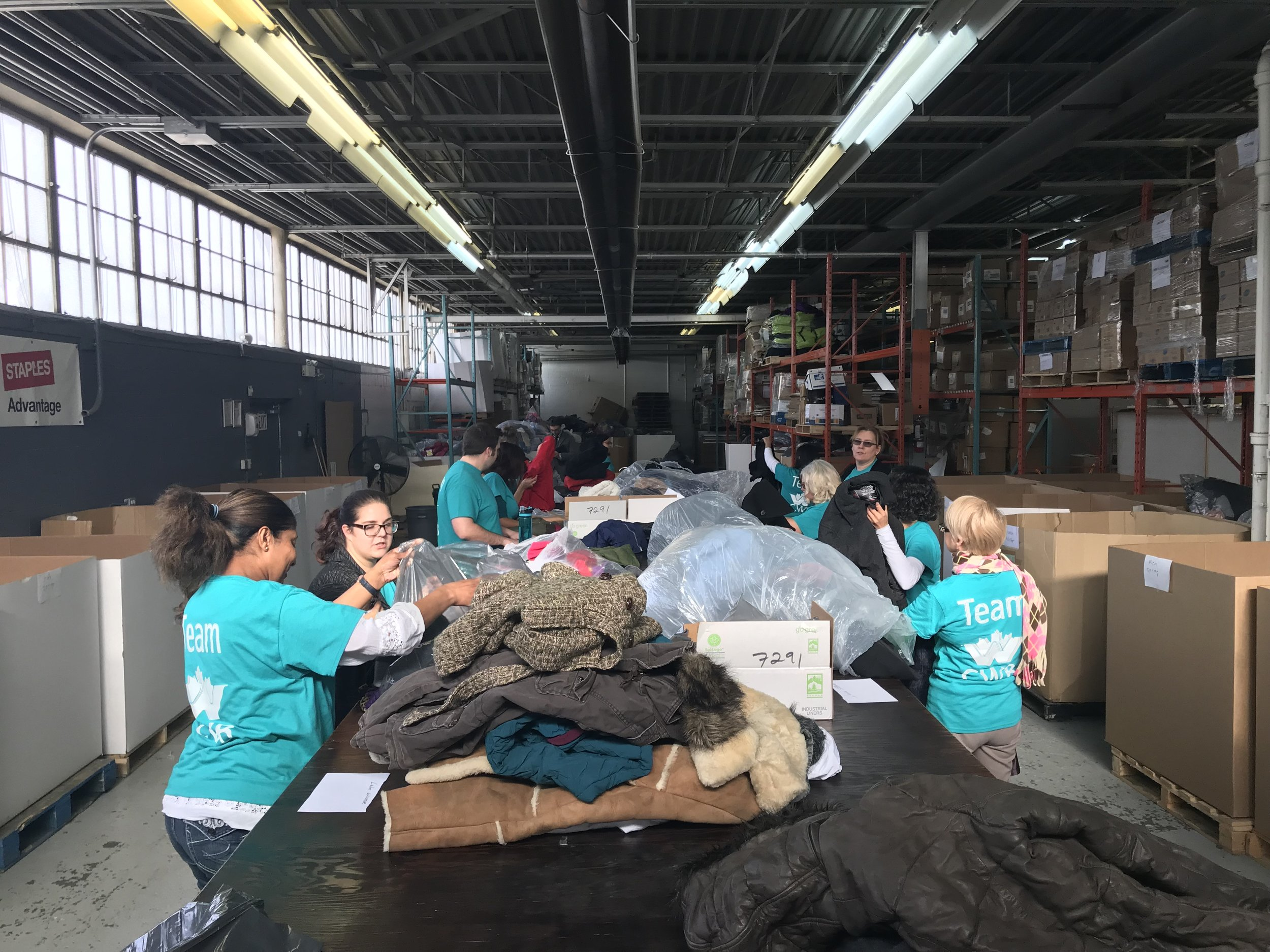 CWB Day of Caring at IKE sorting coats for kids and families