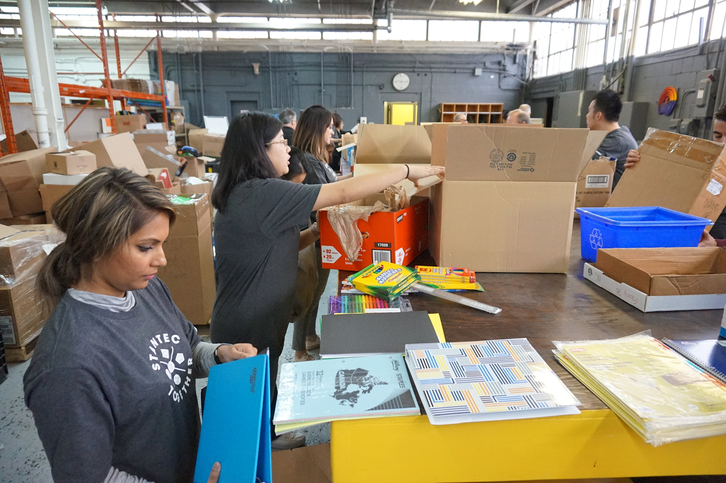 Stantec Day of Caring sorting school supplies