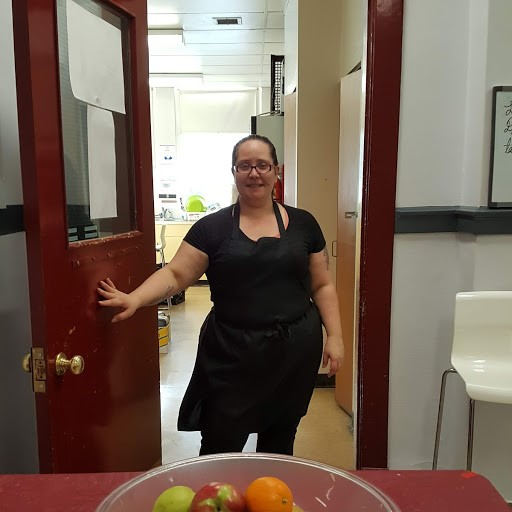 Tamara Kelly welcomes students to the Spruce Avenue School kitchen
