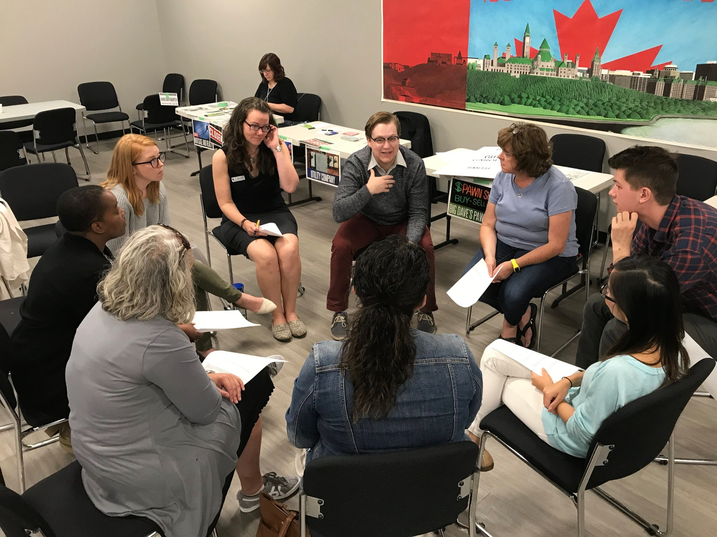 Participants discuss their experiences within the poverty simulation