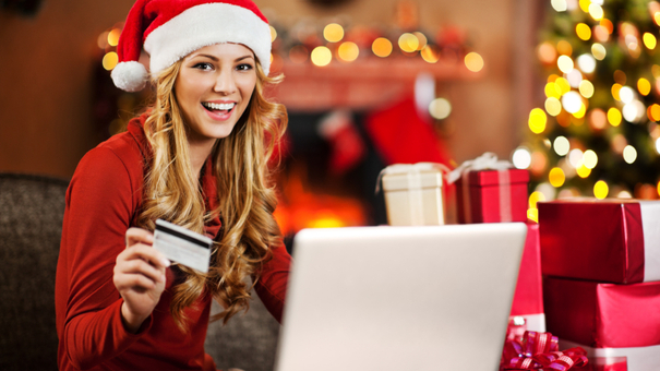 girl_christmas_shopping_online_with_credit_card_iStock_000021878112Small.jpg