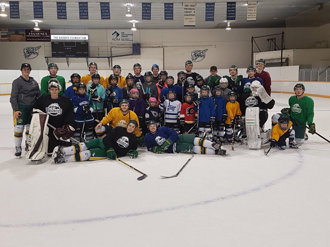 Sam-Jaxon Visscher, the goalie on the right, poses with his former Humboldt Bronco teammates during a trip to nearby Watson for a community skate. Visscher was with the Broncos from August 2017 to January 2018.