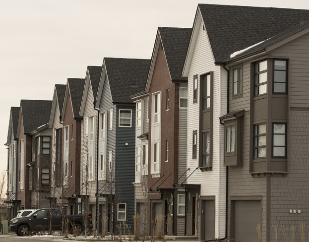 A row of condos along McKenney Ave. At Riverside Drive. Mayor Cathy Heron said there is a big demand for duplexes, condos and starter homes in St. Albert. Of the 23,955 homes in the city, 73 per cent are detached homes.  Photo credit: DAN RIEDLHUBER/St. Albert Gazette