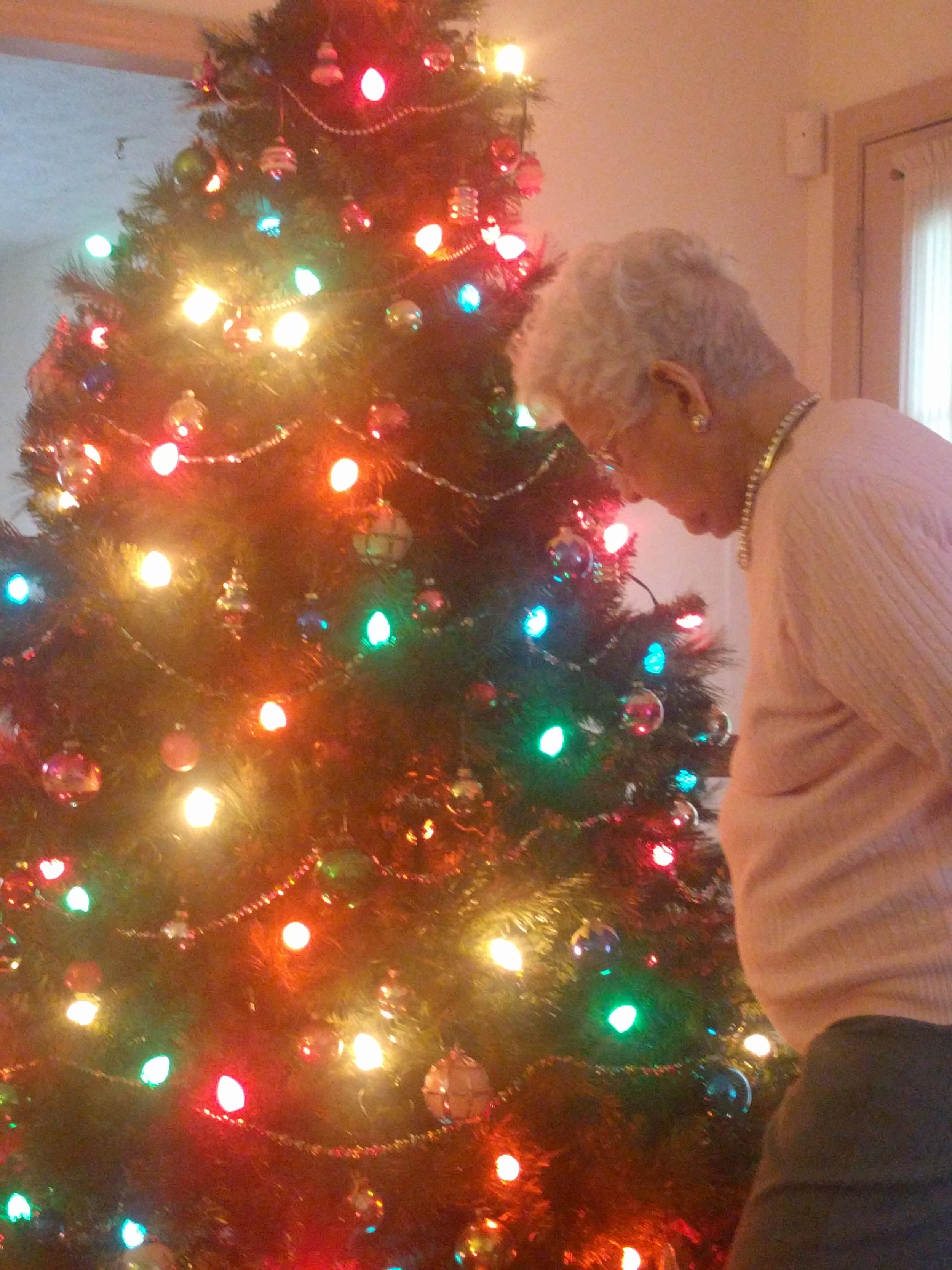 Grandmom admiring Momma's vintage tree. It's decorated with family ornaments from days gone by.