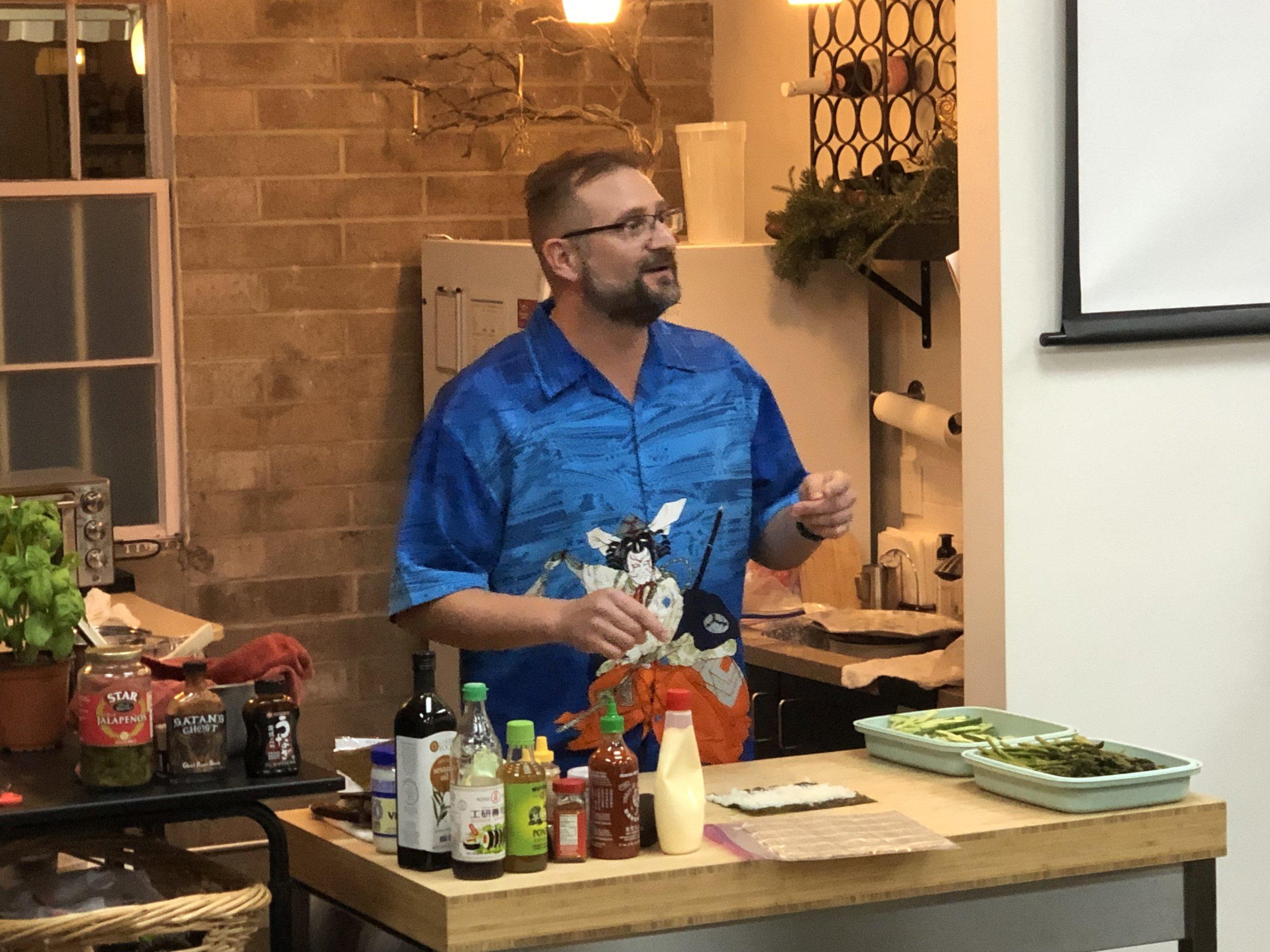 Brett teaching sushi skills.jpg