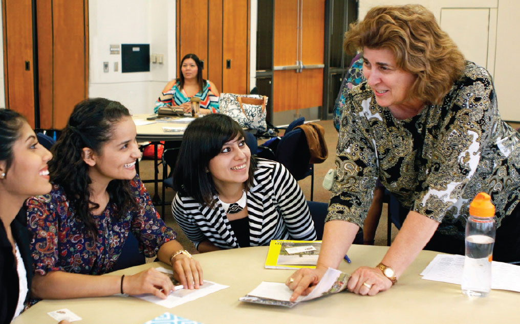 Donna Ekal, Ph.D., right, works with UTEP students.Photo by Laura Trejo