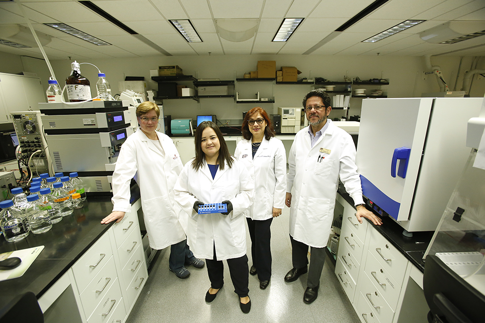 Rosa Maldonado, D.Sc., and Igor Almeida, D.Sc., right, work closely with researchers Katja Michael, Ph.D., associate professor of chemistry; and postdoctoral fellow Eva Iniguez, Ph.D., left.