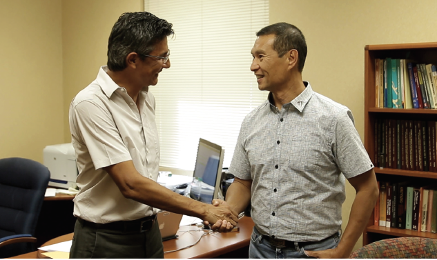 UTEP alumnus Peter Chan, right, greets Cesar Carrasco, Ph.D., professor and chair of UTEP's Department of Civil Engineering, during a campus visit Sept. 13, 2017, where he discussed his second endowed scholarship for engineering students.