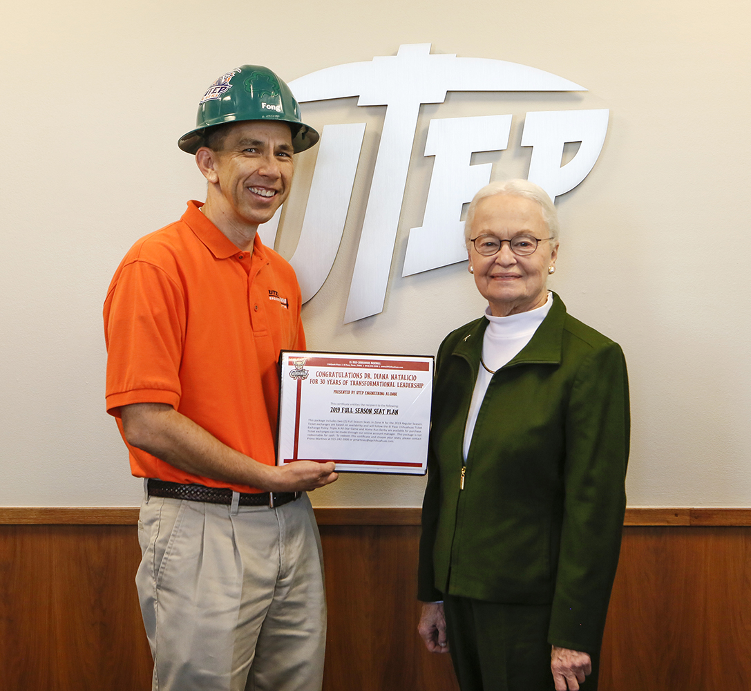 Keith Fong (B.S. Mechanical Engineering '88 and B.S. Metallurgical Engineering '89) with UTEP President Diana Natalicio.    Photo by J.R. Hernandez / UTEP Communications