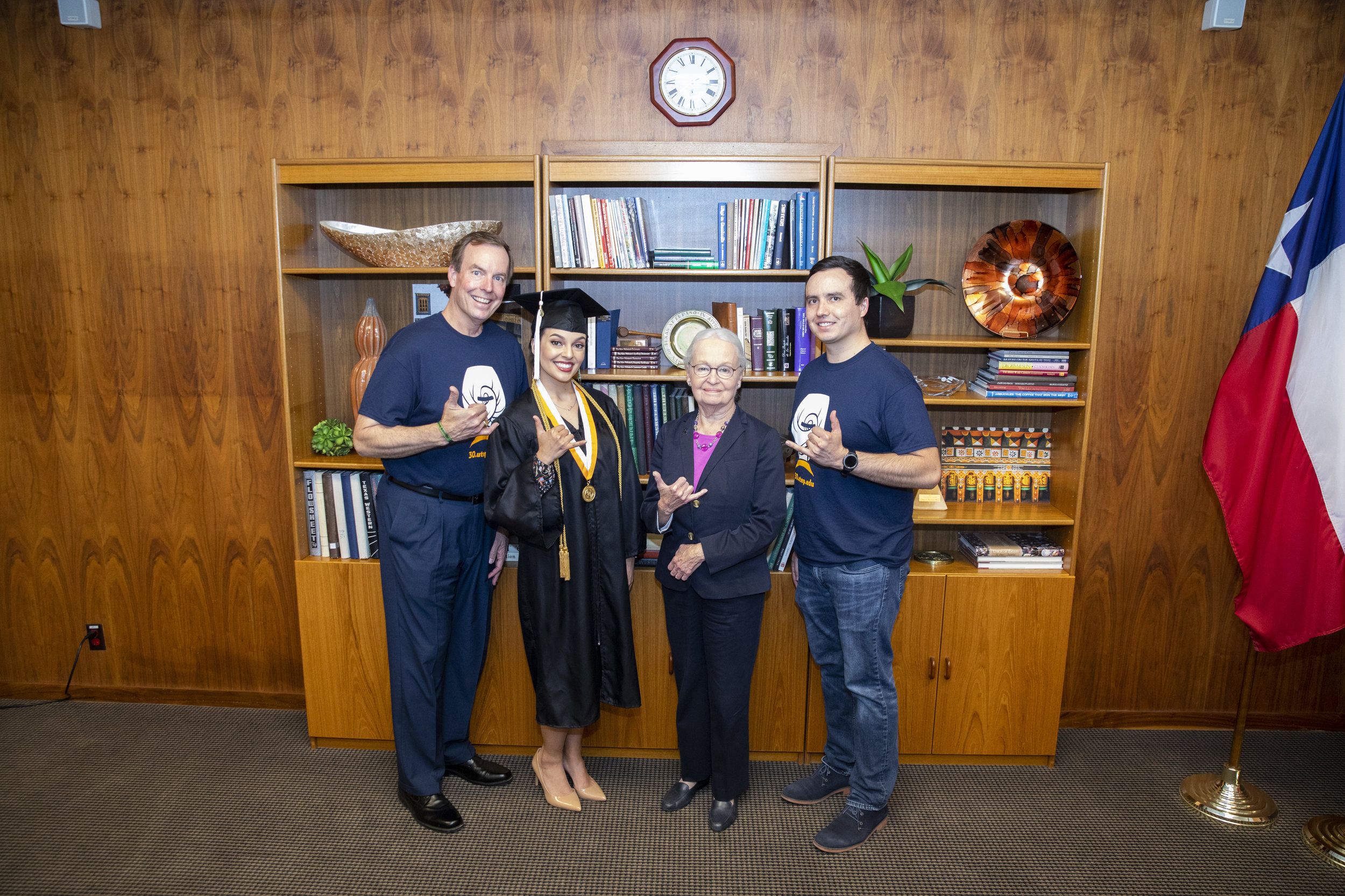 Members of the Hardgrove family, from left, Wallace, Nichole and Joshua, participated in several significant Commencement exercises with UTEP President Diana Natalicio, center right, during her 31 years as leader of the University. Photo by Ivan Pierre Aguirre