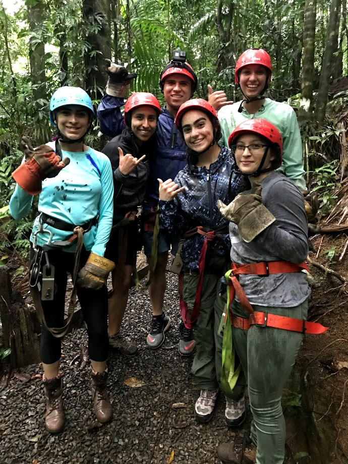 Natassia Lozano, foreground second from right, joins other MHIRT scholars on a zip line and water rafting excursion through the Costa Rican rainforest. Photo courtesy of Natassia Lozano.