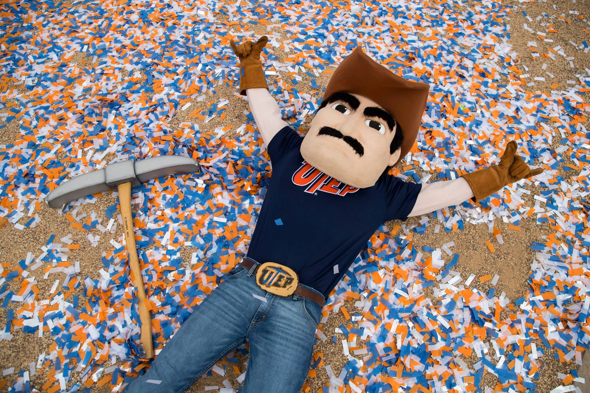 Paydirt Pete makes a confetti angel at UTEP's celebration of its R1 designation from the Carnegie Classification of Institutions of Higher Education on Jan. 29 in Centennial Plaza. Students, faculty and staff gathered to as President Diana Natalicio spoke about the distinctionUTEP Cheerleaders, the Marching Miners, and the Golddiggers joined in the celebration.