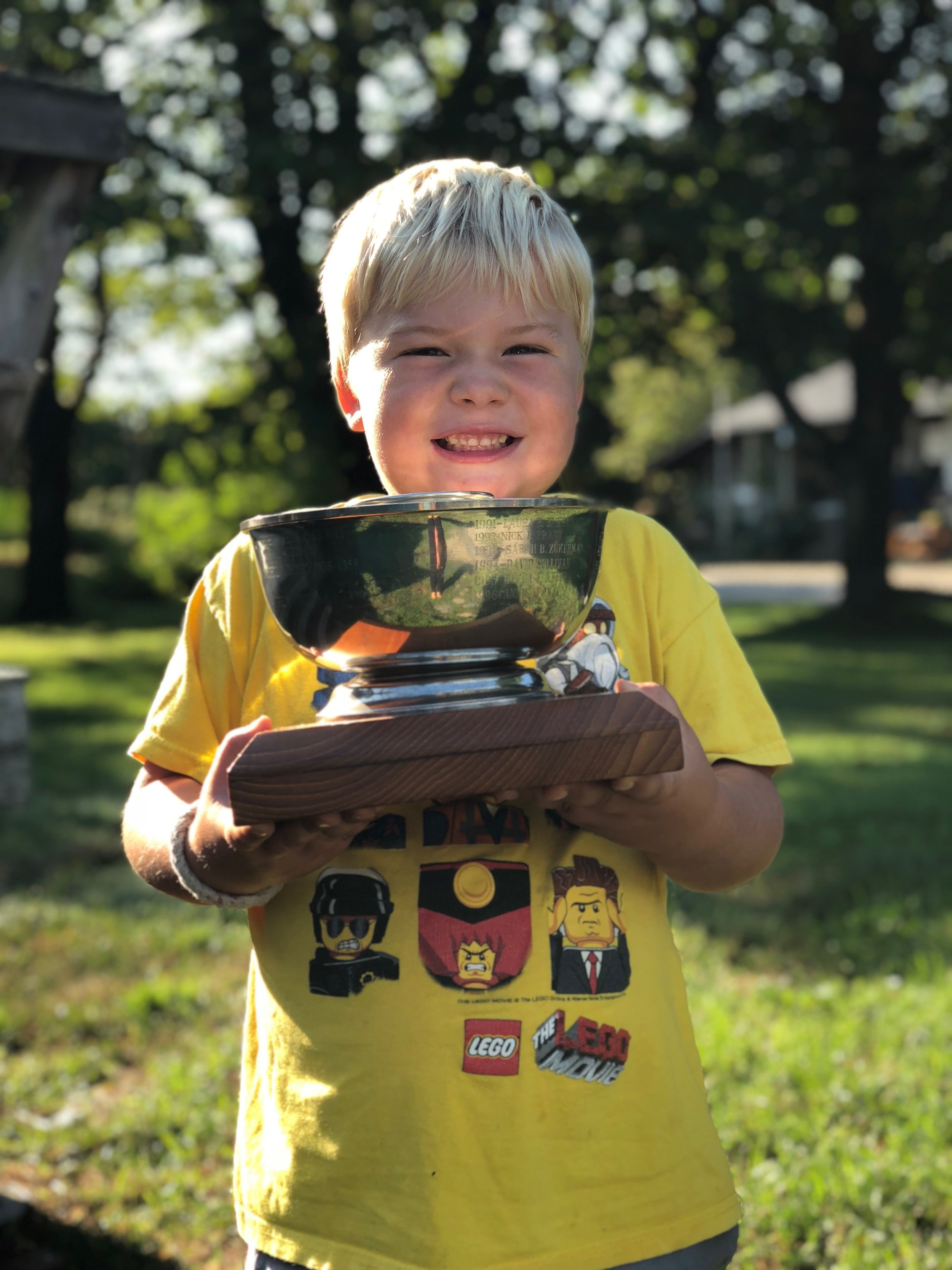 Elliott Hadlock, age 5, with his LCYC Bright- Merrill Trophy. Elliott was awarded the trophy in 2018 for his love of the ocean and willingness to learn.