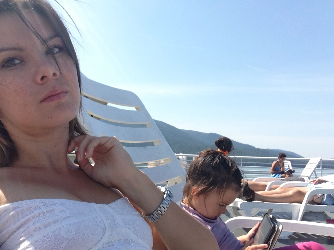 Just taking in some sunshine on the ferry deck.