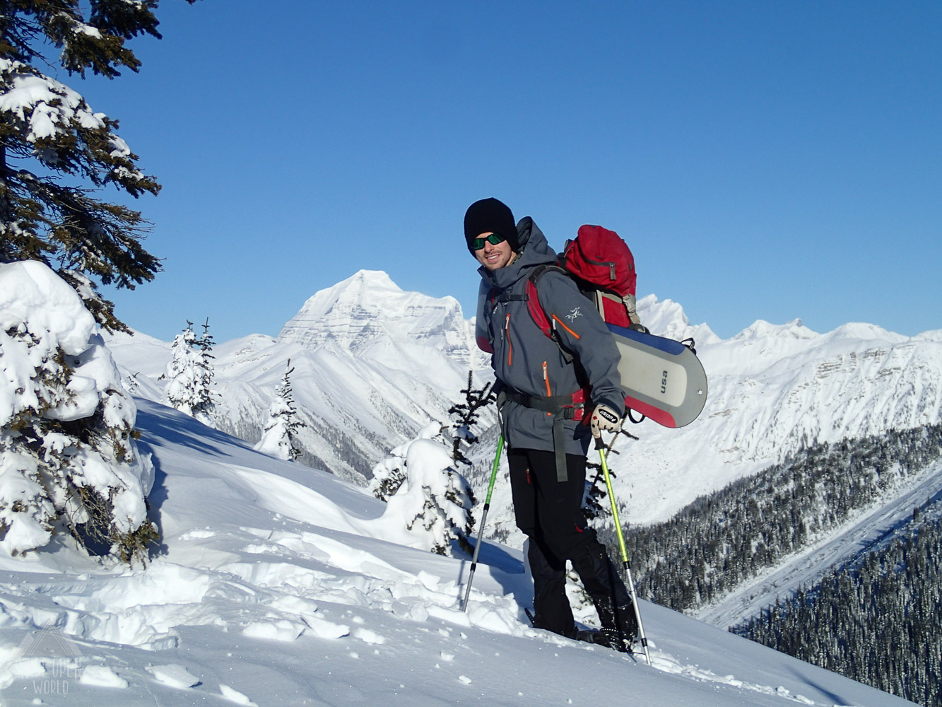 Snowshoeing the meadow with a view of Mount Robson in the background.
