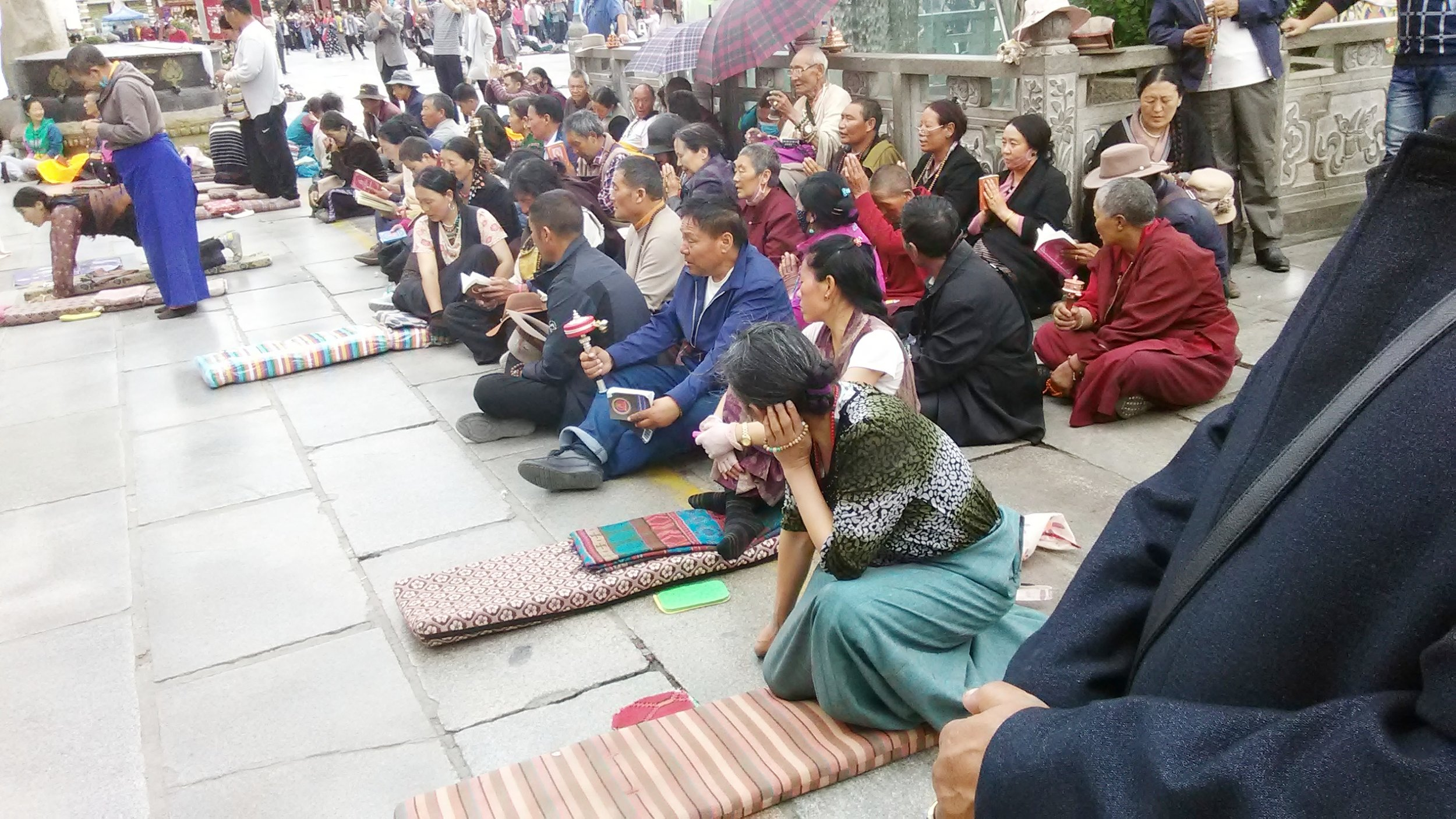 Tibetan pilgrims praying outside the Jokhang. Photo Dechen Steele.