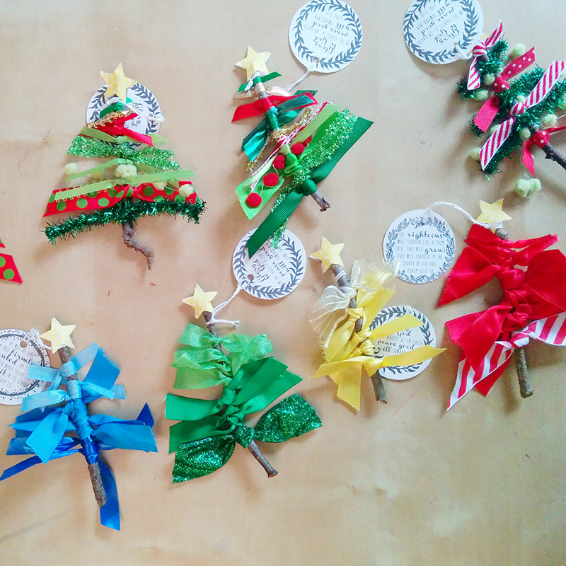 Christmas tree ornaments made with sticks and ribbons.