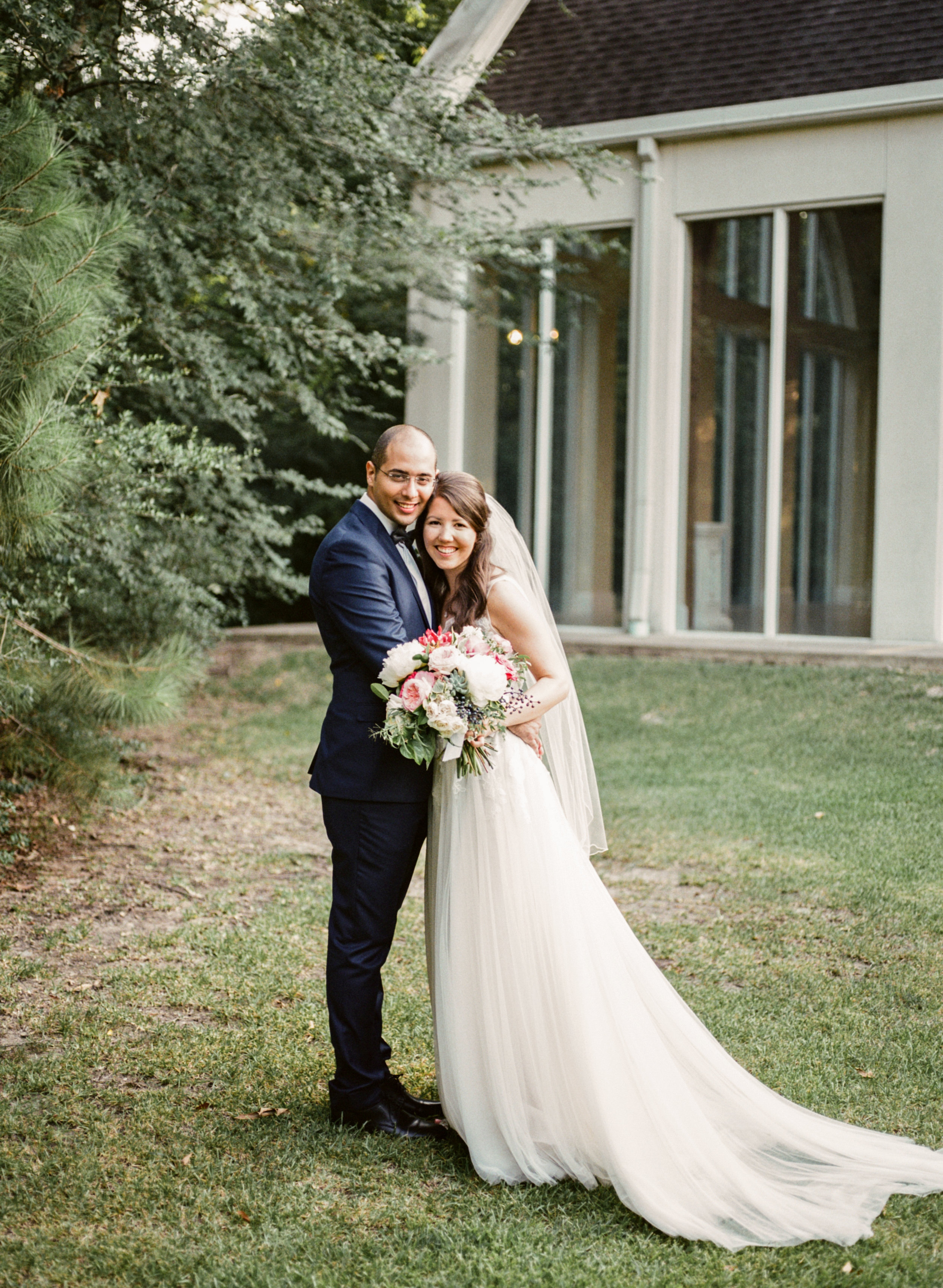 """Lydia + John - """"When I first saw my bouquet in the bridal room, I was stunned. They were so beautiful and even better than I envisioned. While i did not have time to notice some of the wedding details, I kept noticing the florals and was just so in love with them. My bridesmaids can attest to how much I commented on their bouquets and how lovely they all looked with our color scheme. Also, I want to let you know how impressed we both were with how you helped us in planning for the florals. The quote format was so easy to use and helpful as we decided how to maximize our budget. Your confidence and flexibility gave me no reason to stress about the florals.I can't say thank you enough!!!"""""""