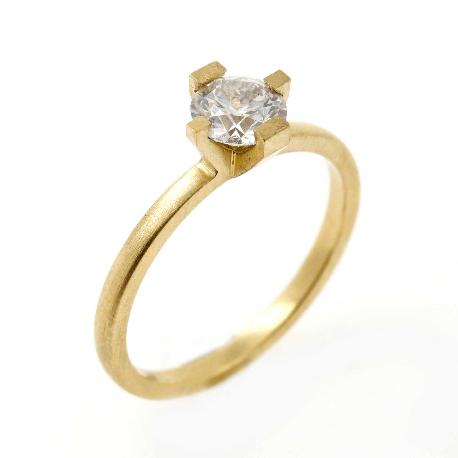 "Architectural Design - Architect Tom wanted us to create a Brutalist inspired engagement ring, with pared back, clean lines and a matt finish to reflect the beauty of the diamond.""I would highly recommend Lee to anyone looking for a beautiful and bespoke engagement ring."" - Tom Saunders"
