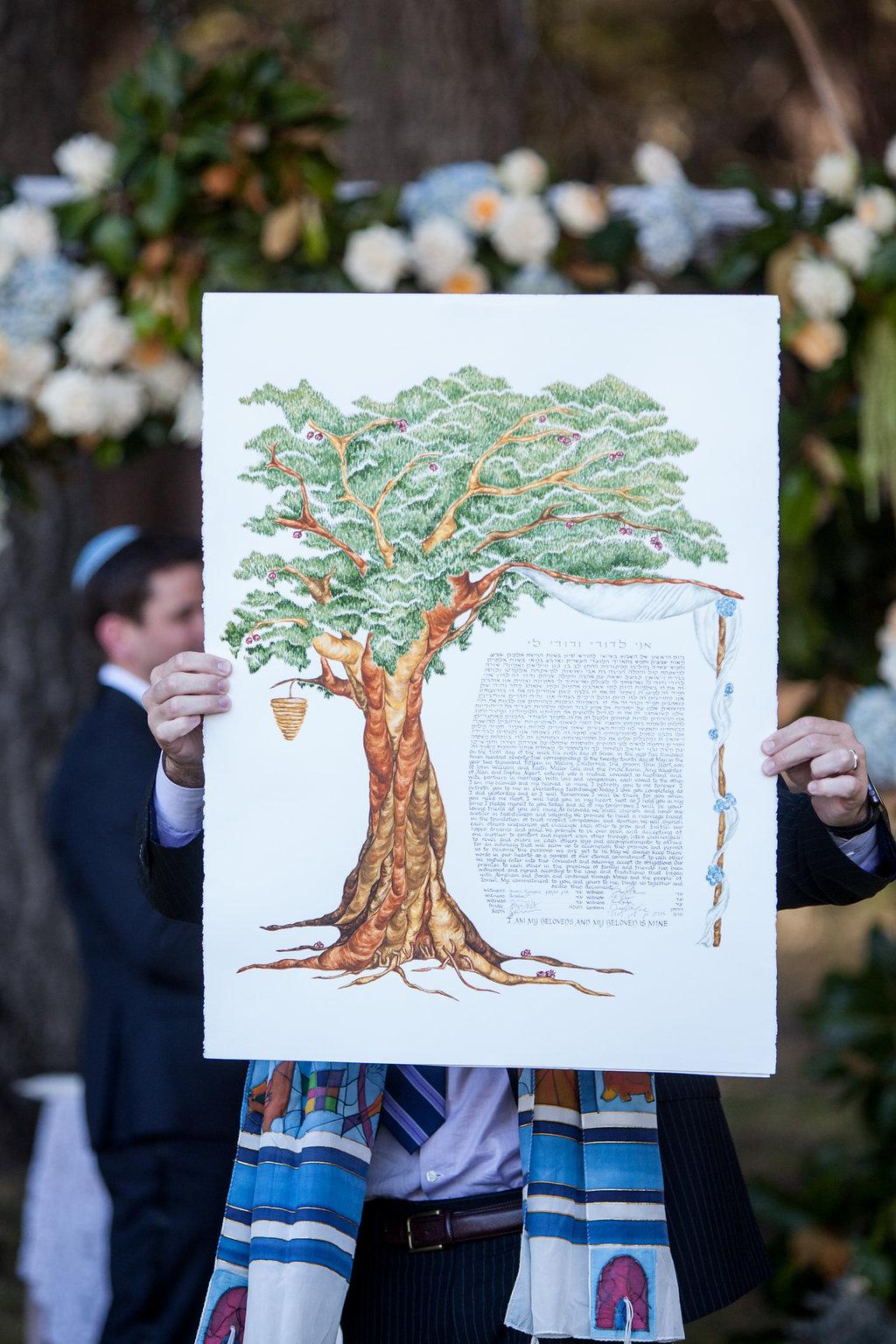 Rabbi holding ketubah