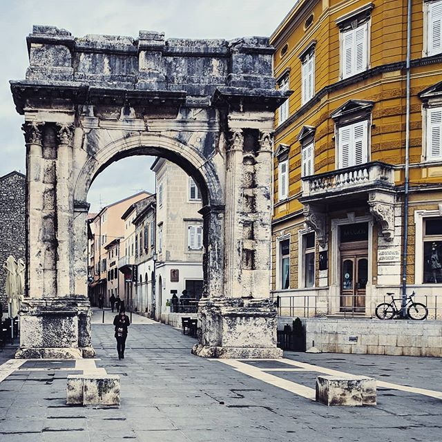Pula is a bit random, it's a bit frowsy and prosaic, then one trips over some Roman ruins. Also known as the Golden Gate (Zlatna vrata), this arch was erected around 27 BC. . . . #romanruins #doyoutravel #letsgosomewhere #traveldeeper #triplookers #athomeintheworld #beautifuldestinations #roamtheplanet #adventurethatislife #lovetotravel #openmyworld #wonderfulplaces #goexplore #travelmore #doyoutravel #adventureseeker #wanderlust #seekmoments #momentsofmine #postcardsfromtheworld #photographyislifee #solotravel