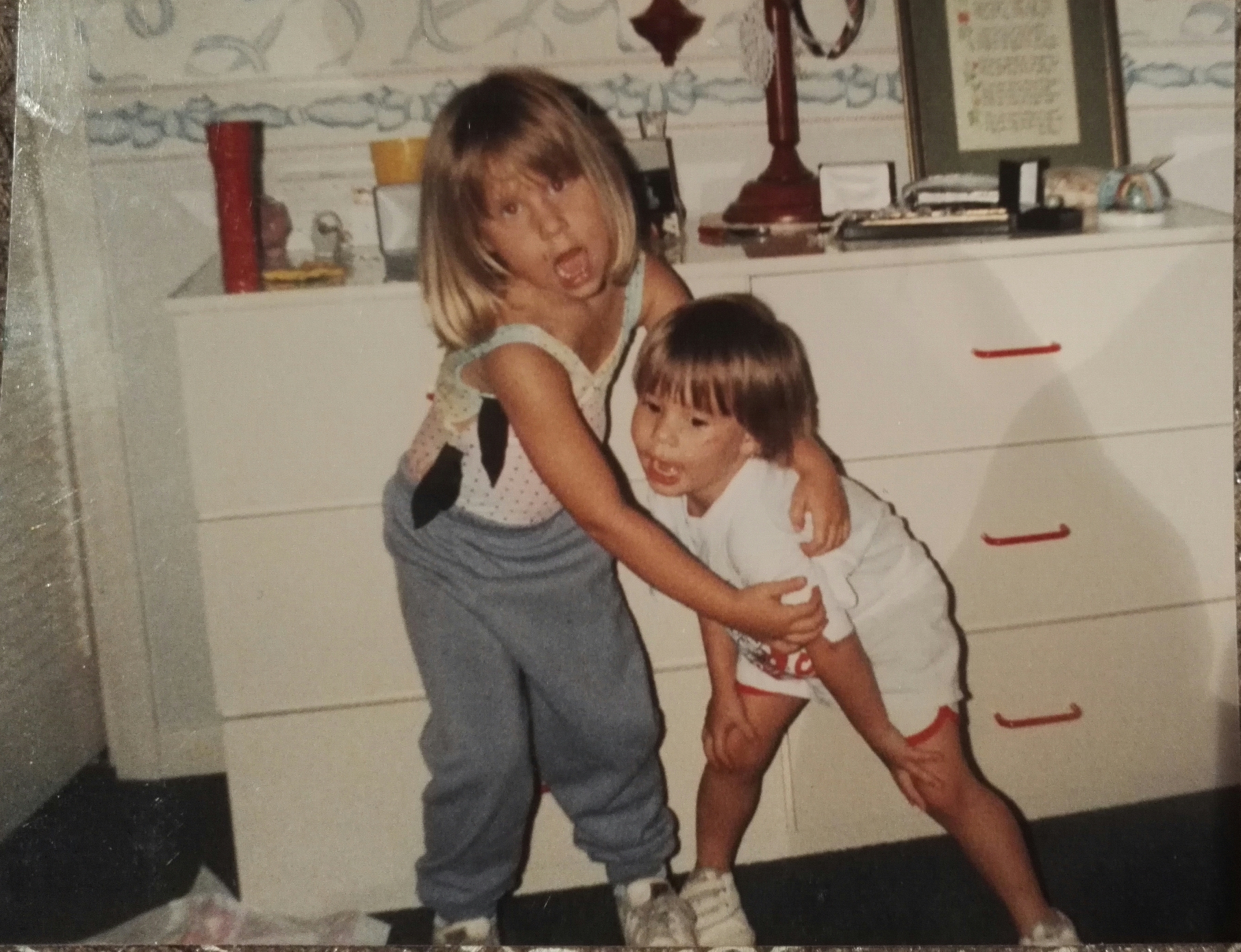 Me on the left, Ally on the right. I'm not sure how old we are in this picture. But I swear we're 17 months apart even though Ally is half my size.
