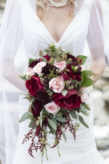 Bride's bouquet inspo - Use large red roses, light cream tones roses, burgundy ranunculus, scabiosa, brunia berry, white waxflower, amaranthus, seeded eucalyptus and salal.