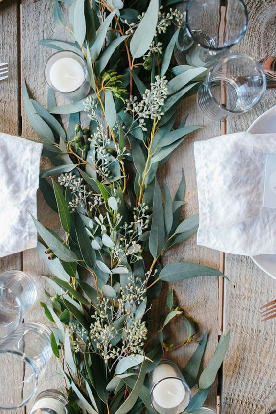 Your tables... - will be covered in greenery garland runners, using the same soft greenery found in the bouquets.