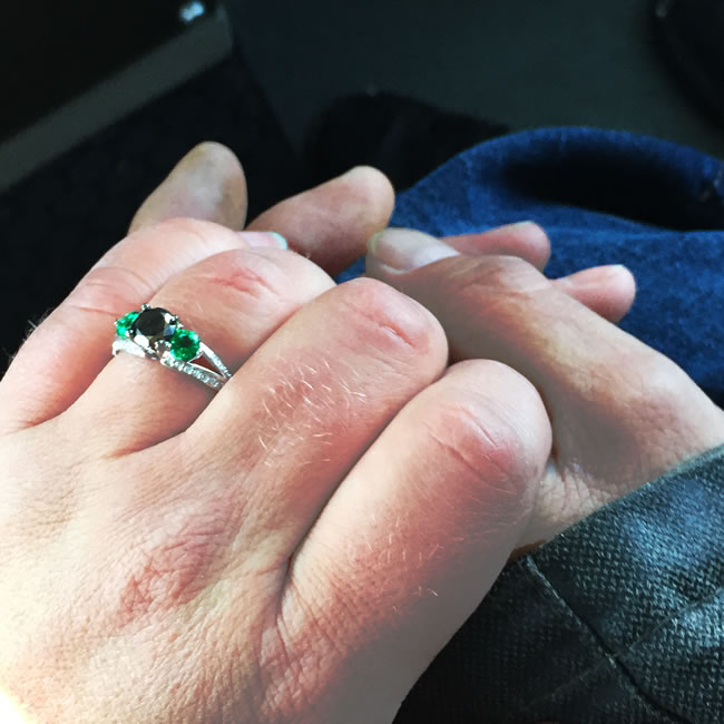 Krista Smith's beautiful custom designed engagement ring showcases Emeralds and black diamonds.