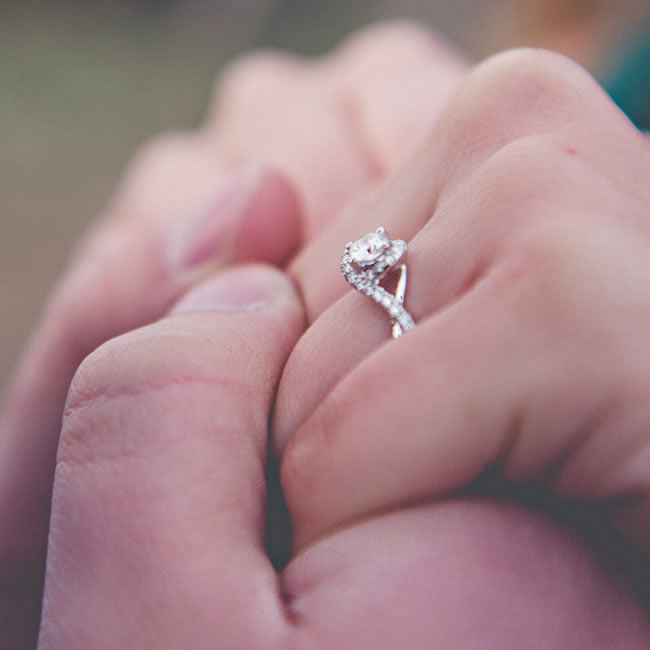 Tabatha's engagement ring is a white gold 14k ring, with a round cut diamond,