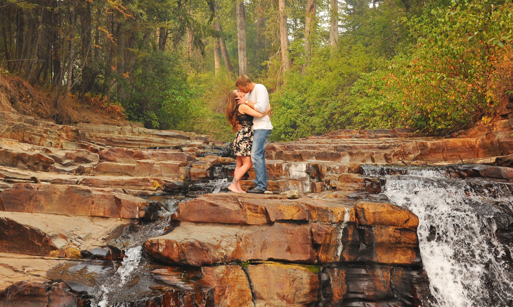 Denielle Maillot and Nick Grady share a moment close to home at Marysville Falls. —Photo by Cassidy Shankowsky, Cranbrook Photo .