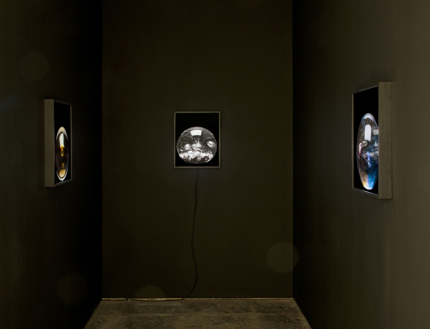 Three  Bubble  lenticular lightboxes installed in     Joy before the object,   Seventeen Gallery, London