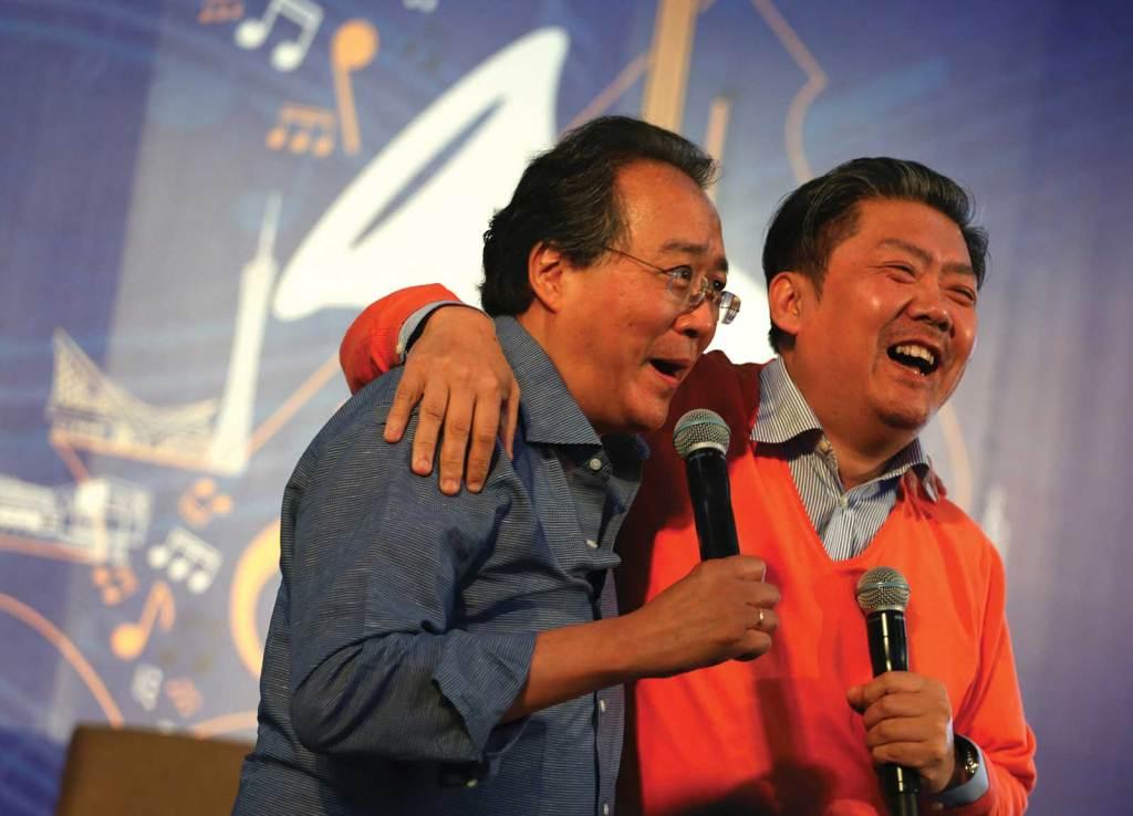 Yo-Yo Ma and Long Yu speak during a YMCG panel discussion. Photo by Liang Yan