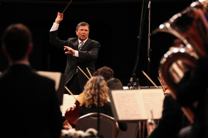 Gerard Schwarz conducting the All-Star Orchestra during the filming of their PBS TV special at the Manhattan Center. (Steve Sherman)