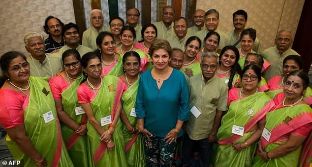 Neeta Helms, president and founder of Classical Movements, poses with the Madras Youth Choir from Chennai, India, ahead of the Serenade! choral festival in Washington