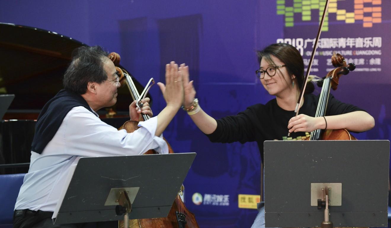Yo-Yo Ma and Australian-Chinese cellist Rachel Siu high-five. Photo: Xiaomei Chen