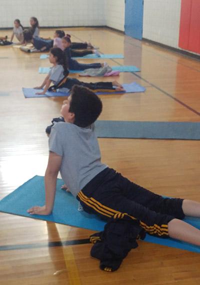 how-yoga-can-help-kids-cope-with-trauma.jpg