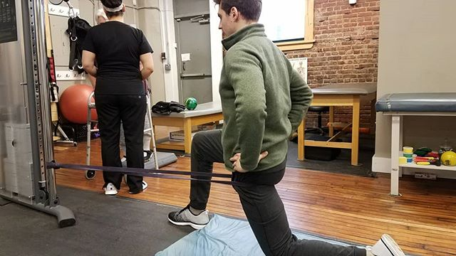 End of the day #rehab at #AHC. Too many people rely on the back for lower body movements which leads to overload and eventual failure. Activate your #glutes to #protectyourback.  See hip flexor stretch with resistance (glut activation with the extension of that hip) in pic and video of prone heel squeeze.  #movewell #moveoften #spinalhealth