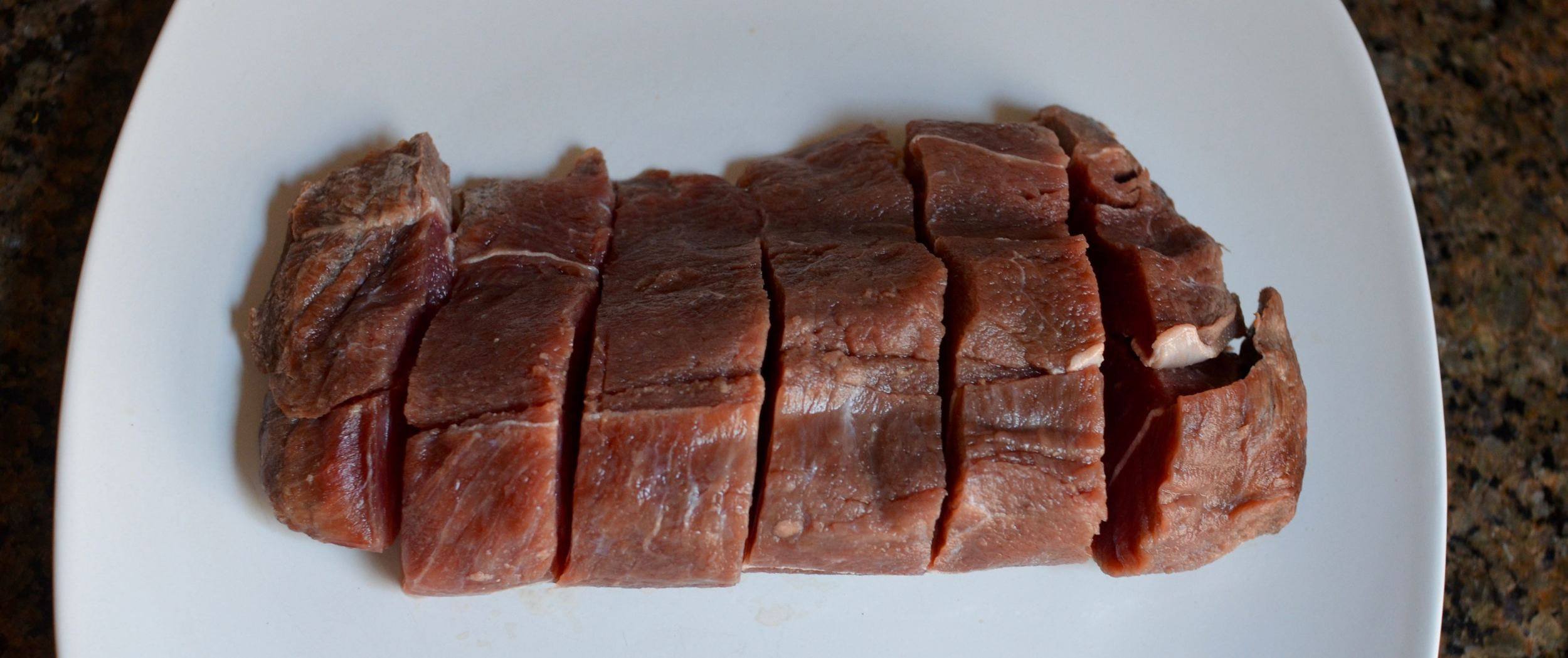 Sliced steak, about 1 x 1 x 3 inches. You can make smaller pieces or keep it as one whole steak.