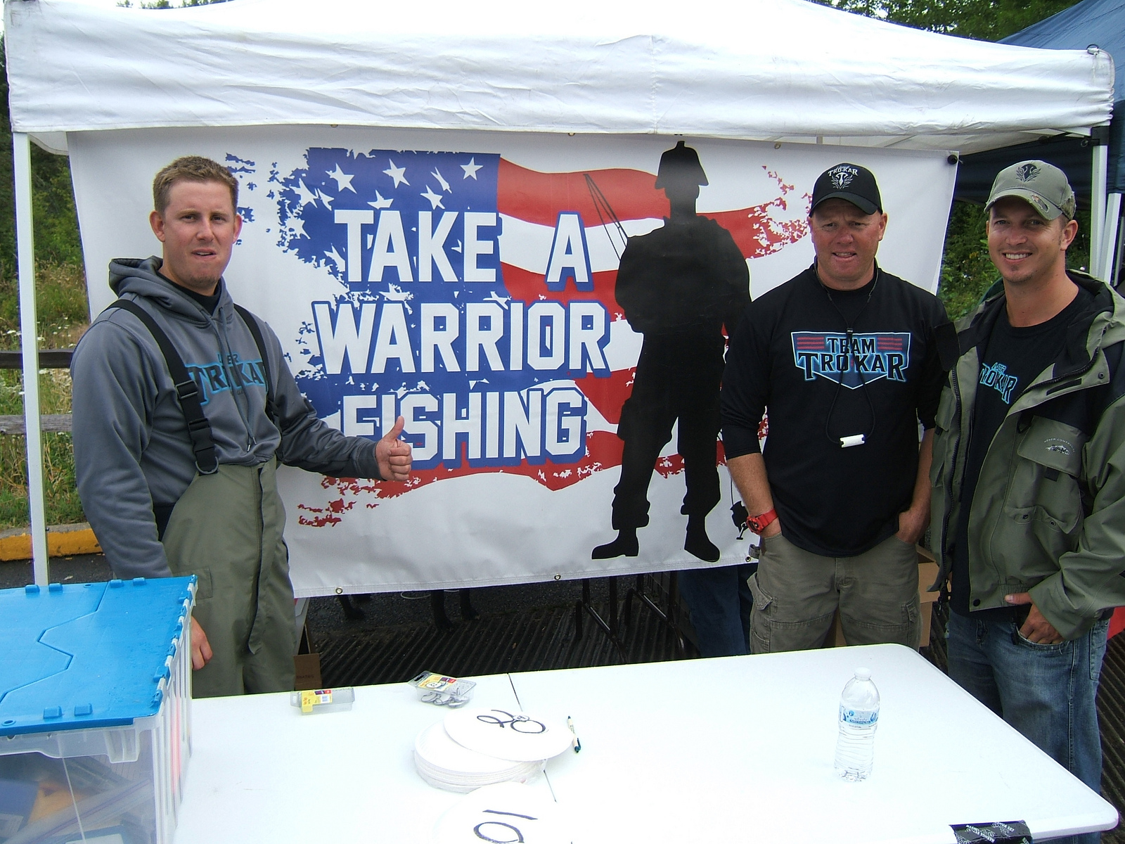 TWF men by banner.jpg