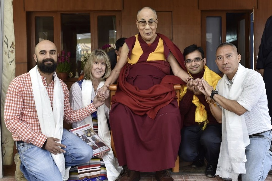 Photo of the Dalai Lama holding hands with Cindy.jpeg