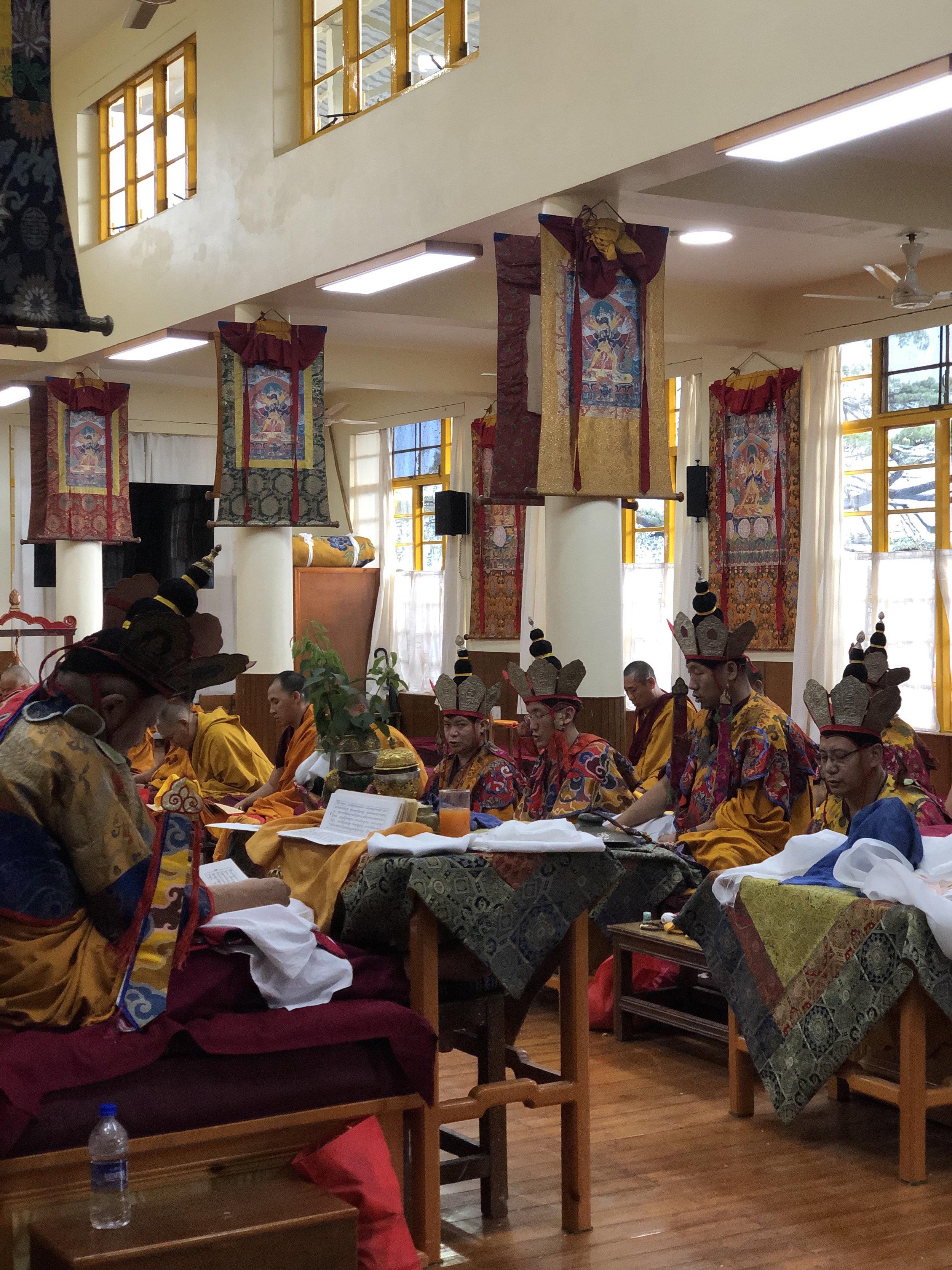 TIBETAN MONKS PRAYING