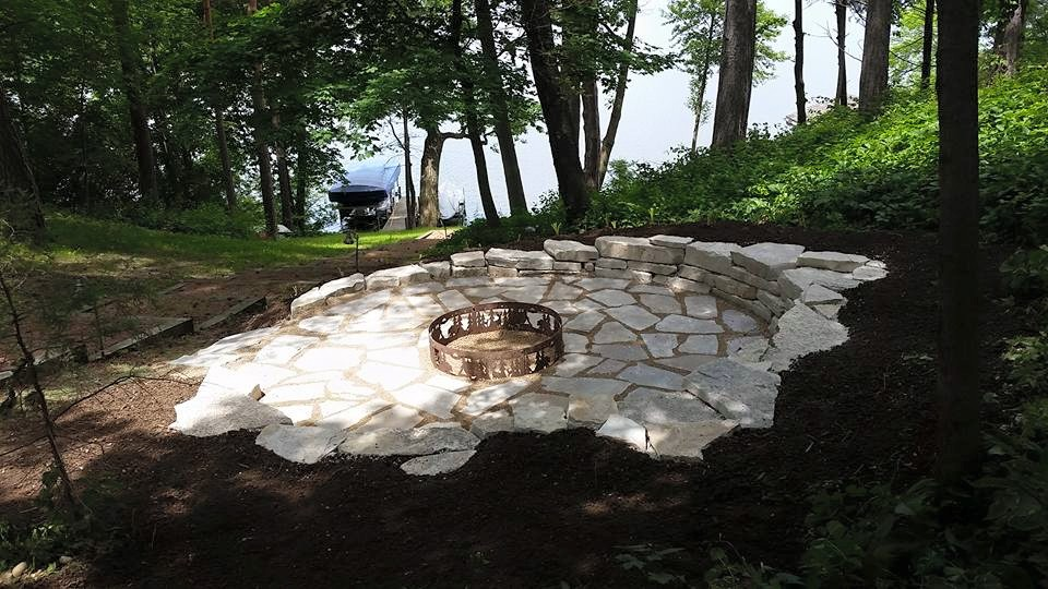 final product - custom fire place and retaining/seating wall overlooking the  beautiful lake