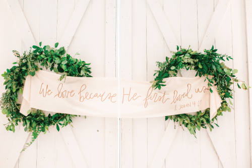 custom lettered backdrop for wedding ceremony with bible verse