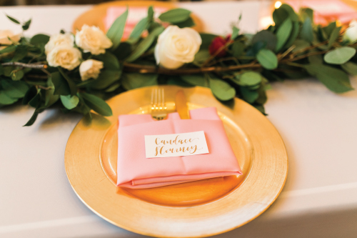 Simple gold calligraphy place cards are the perfect touch to your wedding reception dinner!