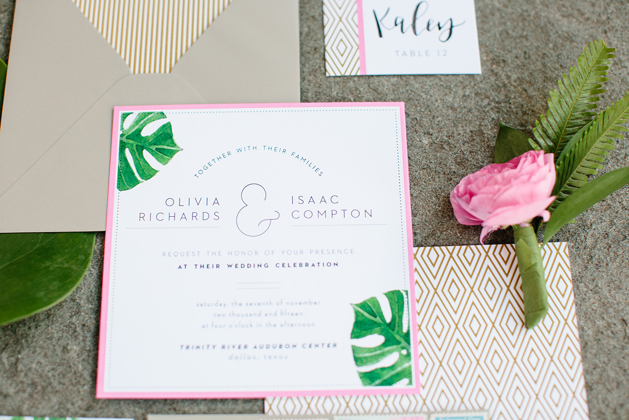 The invitation suite featured watercolored leaves along with pops of hot pink and gold.